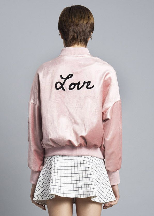 """The perfect retro moment of bomber jacket, whatever! The bomber of your dreams is here, featuring a cropped silhouette and """"Love"""" embroidered across the back. O"""