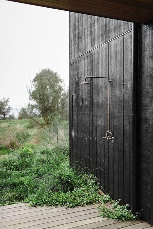 black house, wild outdoor shower