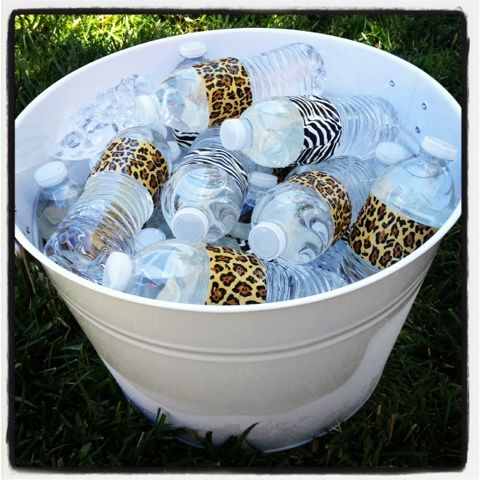 Animal print duct tape on water bottles for a  Safari Baby Shower.  Must less expensive than custom labels