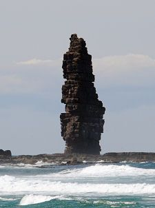 Am Buachaille is a sea stack, or vertical rock formation composed of Torridonian Sandstone, near Sandwood Bay in the Scottish county of Sutherland.