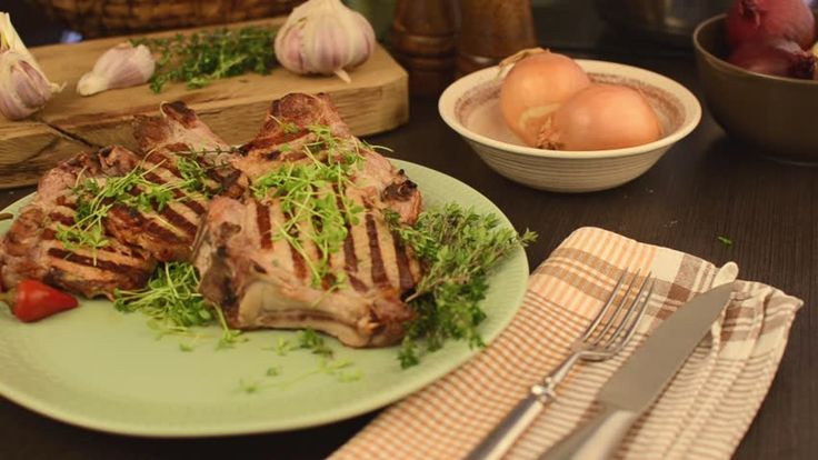 Pork chops grilled with caramelized onion, serving video footage
