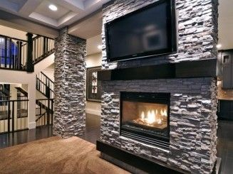 Love the fireplace surrounded by stone. So easy and cheap but elegant. get a  cheap fireplace from costco. then get fauxstonesheets.com panels to go around it. also sell column kits