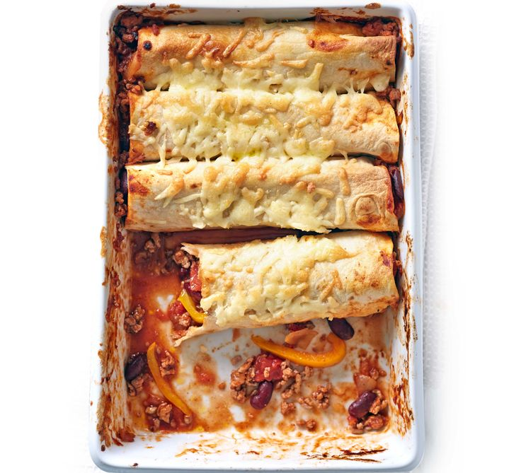 Fill flour tortillas with lean turkey mince in a rich tomato sauce, then top with cheese and bake for a family friendly Mexican dinner