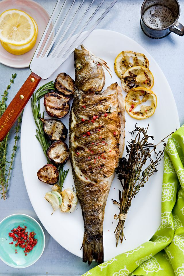 {Grilled whole fish with lemon and pink peppercorns.}