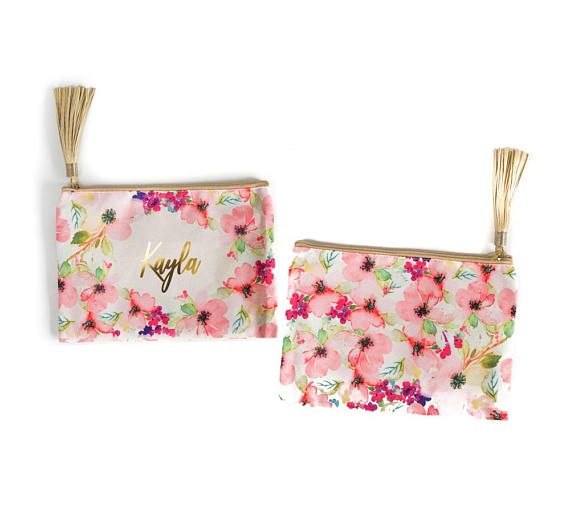 """This cosmetic bag is part of a super cute gift set. It makes such a pretty gift for Easter, birthdays, Mother's Day, graduation or as a bridesmaid thank you present. Each gift set includes a double wall tumbler with straw for both hot & cold drinks. It has a pretty gold lid with a rubber gasket to help prevent any leaks. The cosmetic pouch is 11"""" x 7.5"""" and includes a gold, vegan leather tassel pull. We personalize both the tumbler and bag, too! #gifts #graduationgift #mothersday #florals"""