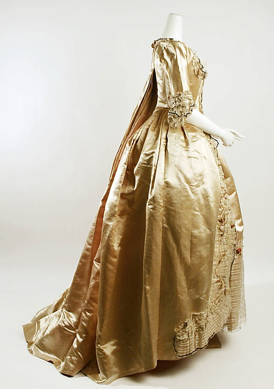 Dress (Robe à la Française) Side   Date: 1774–93 Culture: French Medium: silk Dimensions: Length: 66 1/2 in. (168.9 cm) Credit Line: Rogers Fund, 1932 Accession Number: 32.35.9a, b