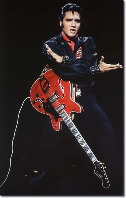 Elvis, 1969 TV special, playing a beautiful 1968 Red Hagstrom Viking II guitar he borrowed from session player Al Casey.  Presley bought a similar one with sunburst finish that John Lennon once borrowed to jam with him.