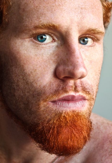 extended goatee facial hair style with red beard hair