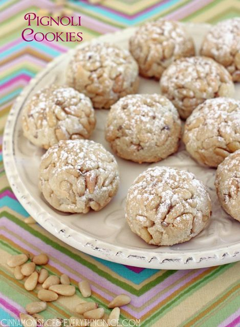 Italian Pignoli Cookies - Classic Italian cookies with soft almond paste middles and a crunchy pine nut coating. They're a must for any holiday cookie tray, even if you're not Italian, and will be the first to disappear. -  Reeni
