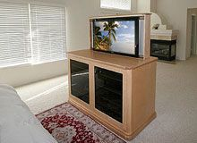 large custom wall unit with display space and angled corners tv lift cabinet on diamondcase