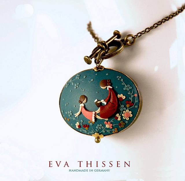 You and I. Two sisters, two friends, mother and daughter, reading together. Beautiful handmade polymer clay pendant. by Eva Thissen Gallery, via Flickr