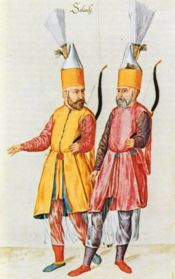 """As a symbol of their devotion to the order, Janissaries wore special hats called """"börk"""". These hats also had a holding place in front, called the """"kaşıklık"""", for a spoon. This symbolized the """"kaşık kardeşliği"""", or the """"brotherhood of the spoon"""", which reflected a sense of comradeship among the Janissaries who ate, slept, fought and died together."""