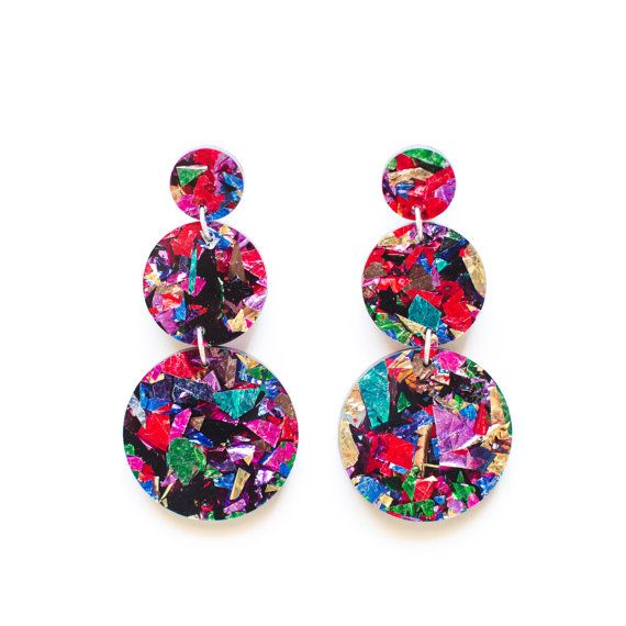 These lovely, long drop earrings are ready to brighten up you day! Made from gorgeous, multi coloured glitter acrylic they have a surgical steel post fitting and are so very lightweight - you wont even know that you have them on. Measuring 9cm long, they are great for a glam night out, beautiful with your cocktail dress or a perfect pop to any outfit. They come gift wrapped in a sweet printed calico bag and will become firm favourites in no time. This acrylic is gorgeously random and uni...