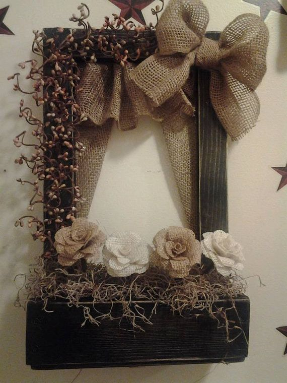 Here is a 16 x 10 Beautiful Black Distressed window with Burlap curtains and valance. A burlap bow is attached and includes 4 Gorgeous burlap