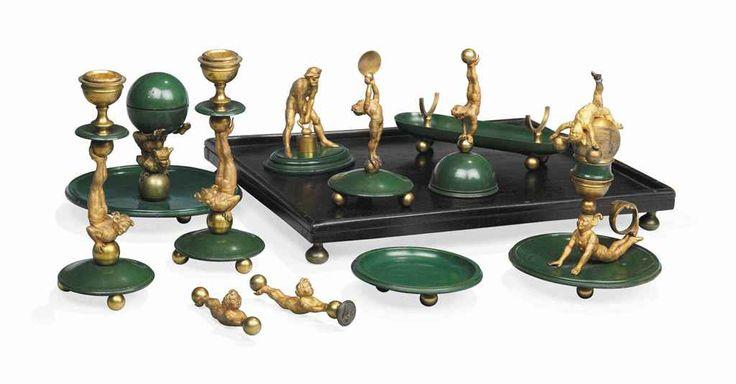 THE 1ST VISCOUNT COWDRAY'S DESK SET: AN ART DECO ORMOLU AND GREEN PATINATED DESK SET CIRCA 1920