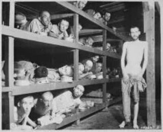 "A rare picture of inmates inside the Buchenwald concentration camp Weimar Germany. This was one of the earliest concentration camps (actually slave camps) inspired and directed by Fuhrer Adolf Hitler's hate message against Jews and ""mixed-blood"" Europeans. The camp at its peak of operation imprisoned about 240 000 persons from all over Europe. An estimate of about 56000 persons were said to have died in this particular camp. The inmates were liberated on April 4th 1945 by the Allied forces."