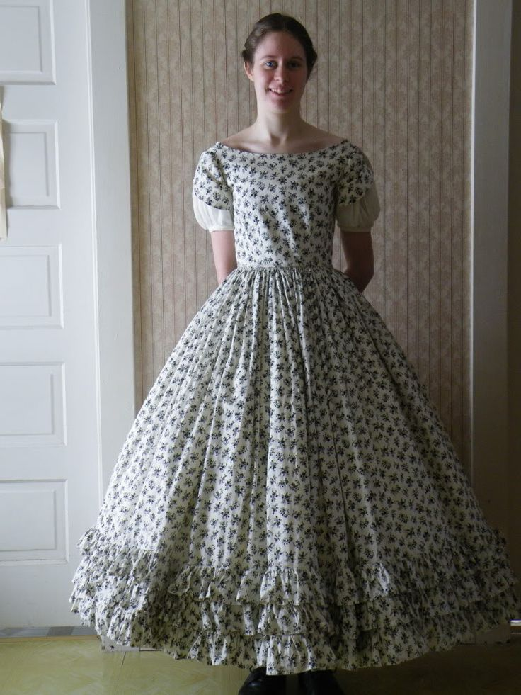 Teen's dress with open petal sleeves and rows of fine ruffles. Teen girls were able to wear wider necklines, short sleeves and and above-the-ankle skirts until they reached the age of 16-18 when they would move into a woman's wardrobe.