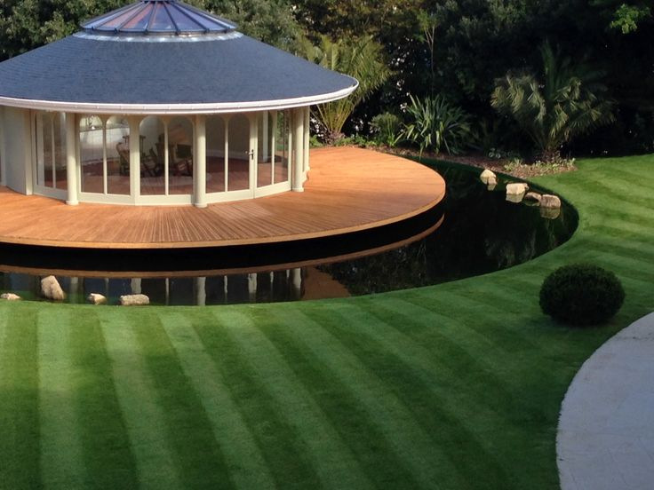 Garden design in Guernsey complete with a circular bandstand and moat. EverEdge steel lawn edging was used to create a clean and unobtrusive edge between the water and the lawn.