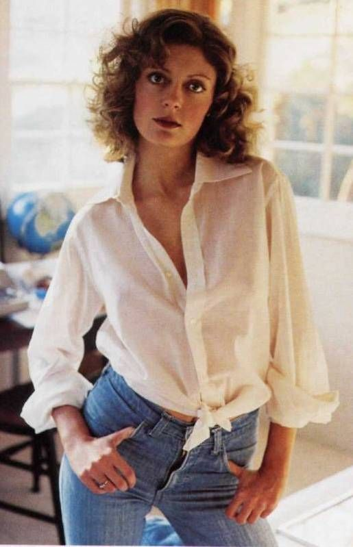 Thelma and Louise, loose, lightweight collared blouse with rolled sleeves paired with light wash denim and short cowgirl boots