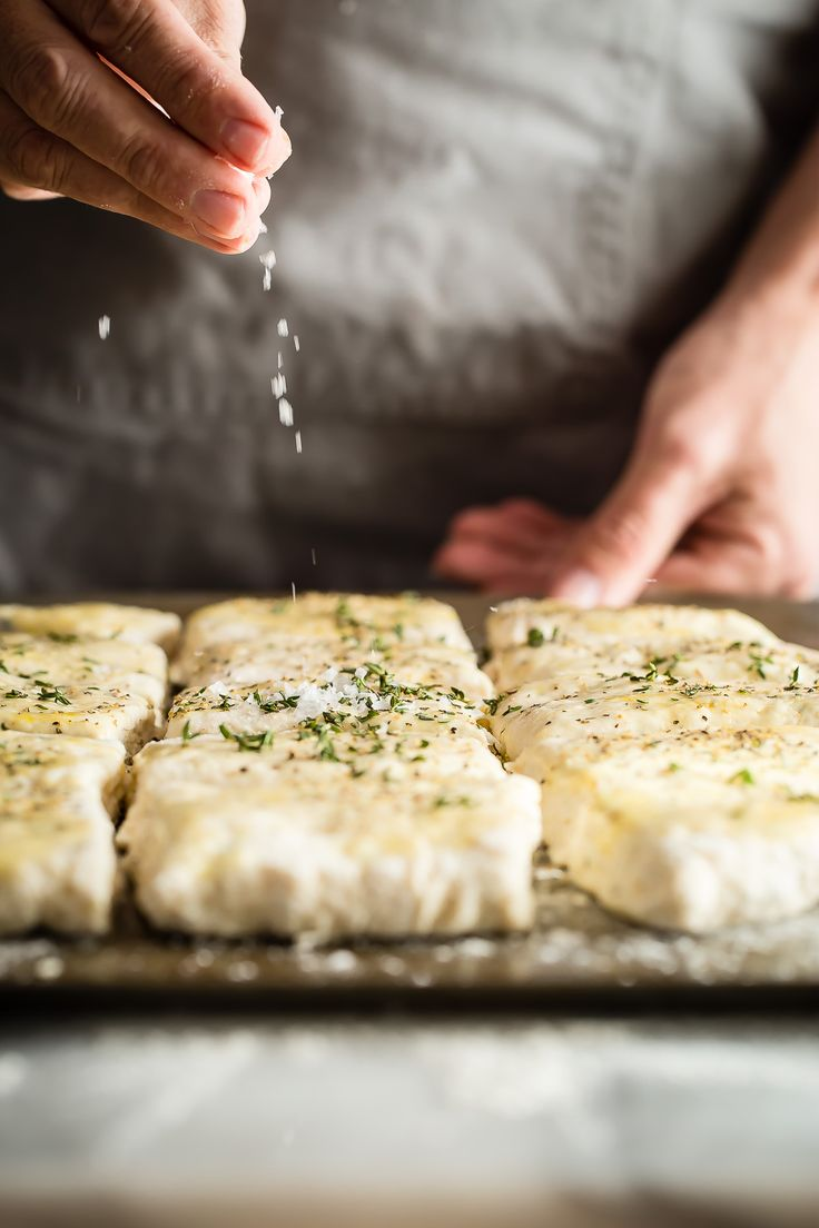 Flaky buttermilk biscuits with fresh thyme and glazed with garlic butter