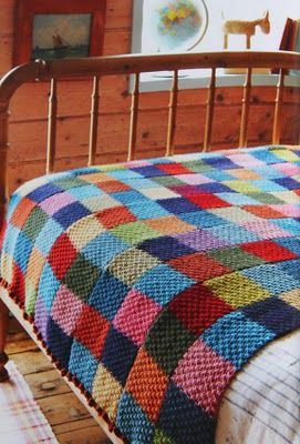 "For this blanket, Jane used double moss stitch and knit five ""scarves"" that were then sewn into one big blanket.  Great idea."