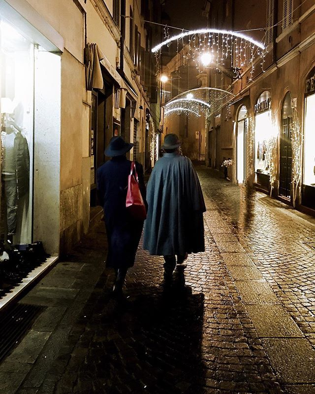 Strolling through the streets of Parma. We're glad to inform you that capes can indeed be worn by normal men. #butonlyinitaly
