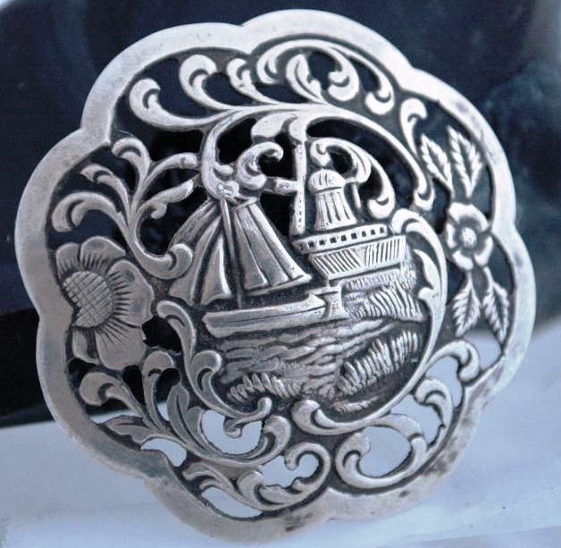Antique Dutch Harbor Silver Repousse Brooch Pin with Sailboat and Windmill Scene. Repinned by one of WorthPoint's favorite pinners!