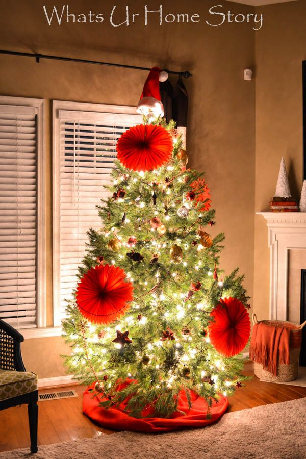 Eclectic Christmas tree with paper party decorations as ornaments