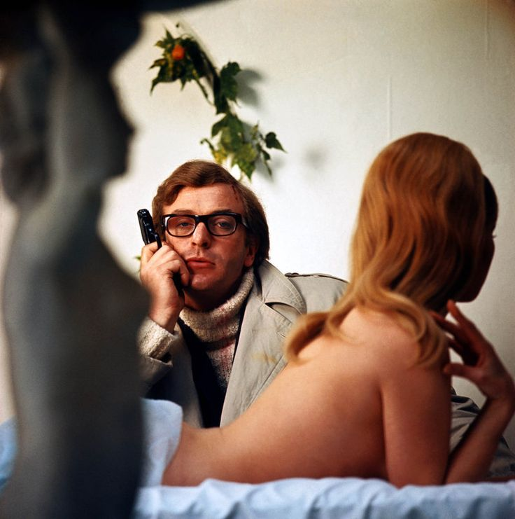 Michael Caine with a gun