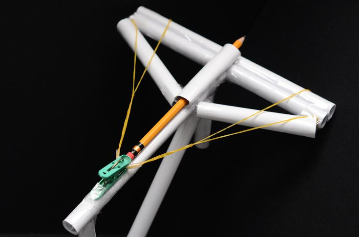 If you have a little extra time on your hands and some spare office supplies lying around, you can build a surprisingly durable paper crossbow that actually shoots. Here's how it's done. Grab three large rubber bands. The rubber bands...