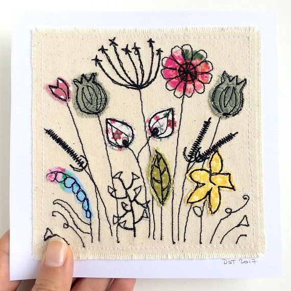 Wildflower Meadow framed wall art. A handmade stitched appliqué picture on canvas. This item comes in a white 8x8 frame with white mount included. Image size is 6x6 inches including backing card. You have a choice of frame - either basic mdf with plastic coating, or high quality