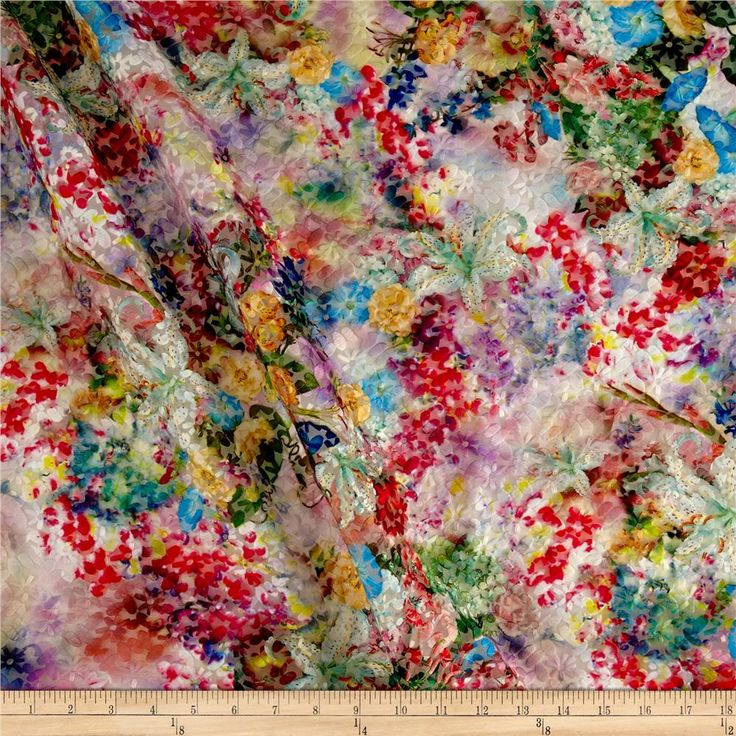 From Telio, this unique fabric features embroidered polyester flowers on an organza backing. The embroidery features a slight sheen and the color variations give the fabric a tie-dyed look. Perfect for special occasion apparel, overlays on skirts and dresses, appliques, insets, and more!