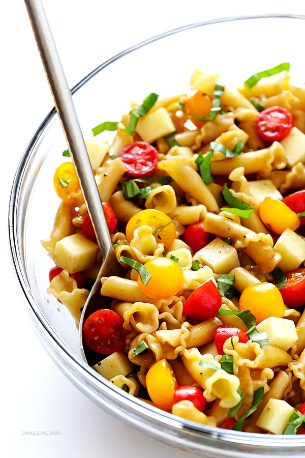 This Caprese Pasta Salad Recipe is quick and easy to make, tossed with a delicious balsamic vinaigrette, and perfect for picnics, potlucks, or just a regular weeknight meal! | gimmesomeoven.com
