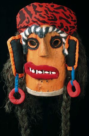 Romanian Folk Mask. Transylvania, Romania. Painted wood, cloth, fiber hair, & beans. An authentic folk mask made by Nicolae Popa for the traditional Christmas/New Year celebration that is still popular in many rural villages.