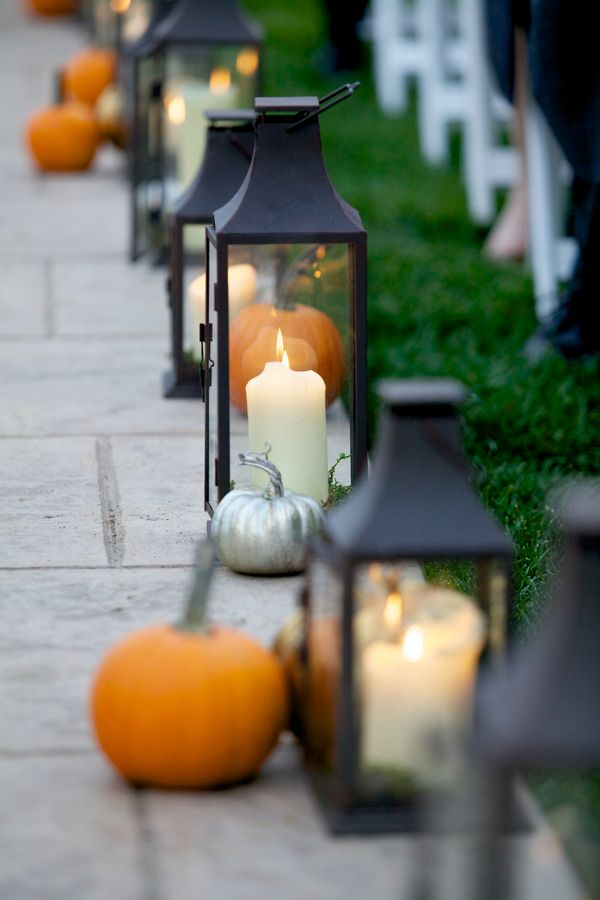 Fun idea for a fall wedding: line your aisle with pumpkins and lanterns! /// Photo by Langdon Photography via Project Wedding