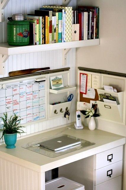 How to Organize Your Workplace - love the wall mounted organiser for notebook, diary etc