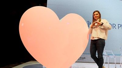 Simona Halep makes a heart to support premature babies  #cocacolaHellenic #sustainability