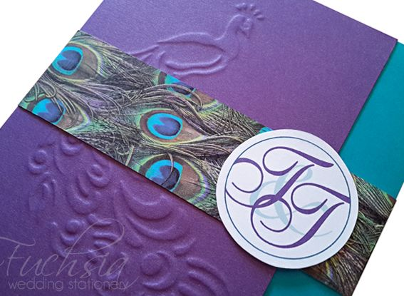 Had so much fun creating this #peacock themed #weddinginvitation in #purple & #teal.  #embossed #weddingtrends #weddinginspirations #fuchsiadesigns