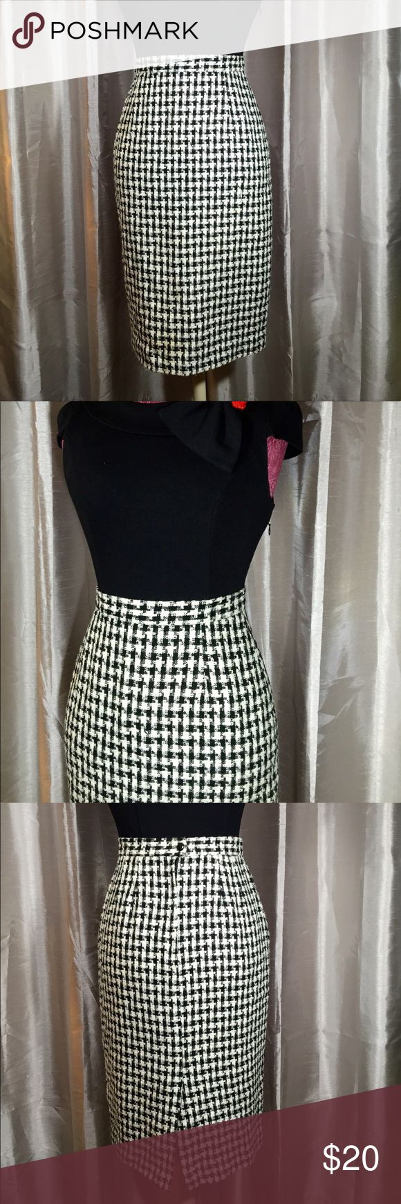 VNTG Black & White Gingham Pencil Skirt Vintage black and white gingham print pencil skirt/ wiggle skirt. Very wool like. Very chic and 1950's trendy. Pairs great with black knee high boots in winter or heels or flats in spring.  Tag says size 6. Fits like a medium.  94% acrylic/ 6% polyester   Measurements: Waist: 28 inches Length:  26 1/2 inches  Make make me an offer! I love to make deals! Vintage Skirts Pencil
