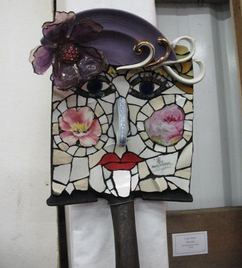 Mosaic face love it, and its on a shovel