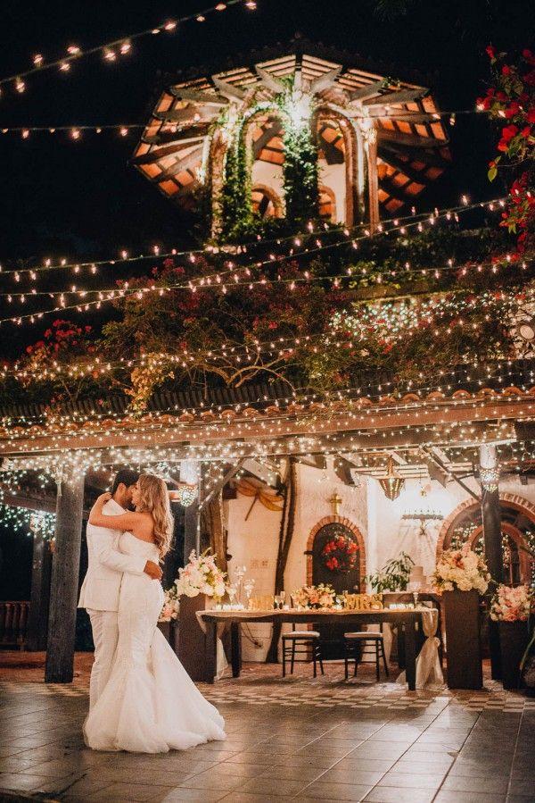 This wedding is an absolute fairy tale with all of the twinkling lights | Photo by Evan Rich Photography via http://junebugweddings.com/wedding-blog/romantic-puerto-rican-wedding-hacienda-siesta-alegre/