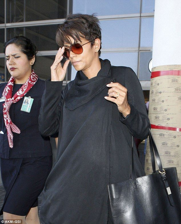 Rare solo flight: Pregnant Halle Berry looked surprisingly disheveled as she landed in LAX Monday with bedhead after an 11-hour flight from Paris
