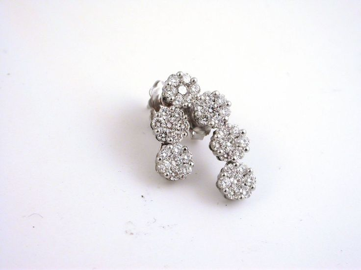 Earrings - Invisible frame. 18 carat gold (kt), 9 white gold: 8.00 grams (gr).White diamonds brilliant cut: total weight 2.10 carat (ct) (H colour VVs clarity).Codex: Mlss.
