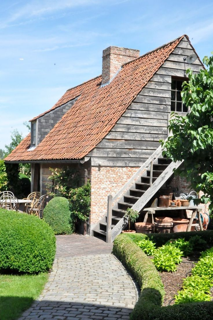 Love the stone path and potting shed under the stairs.