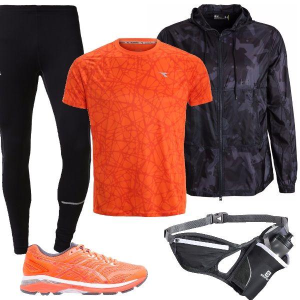 Scegliamo un bel look anche per la corsa mattutina. Abbiamo collant aderenti black, t-shirt con stampa vermillion orange, giacca a vento black, scarpe da corsa stabili orange, borraccia con comoda cintura regolabile. Pronti per iniziare la giornata.