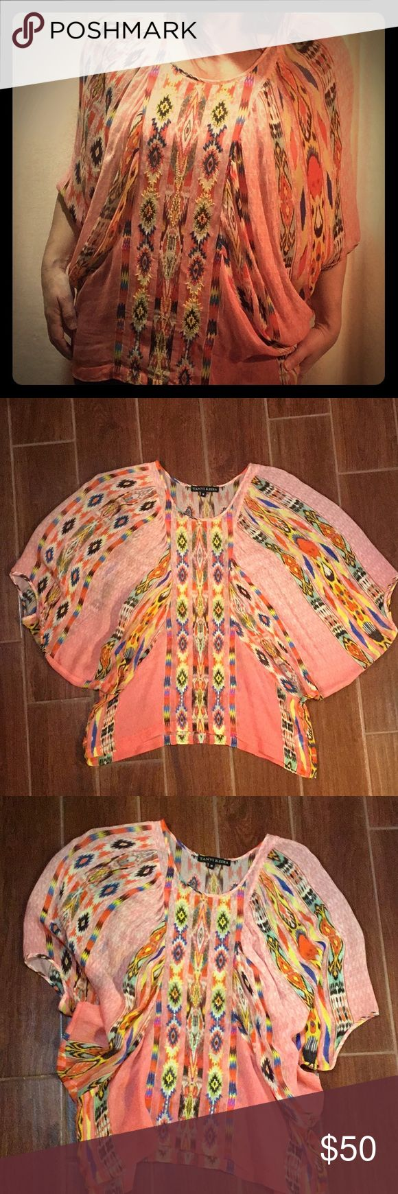 Beaded Anthropologie Tanvi Kedia Top SIze Medium Beaded Anthropologie Tanvi Kedia Bohemian Style Blouse. In great condition! This blouse flows and definitely has a bohemian vibe with beautiful bead embellishments down the front. Size medium medium and 100% Rayon. Bundle up!  Offers always welcome! Anthropologie Tops Blouses