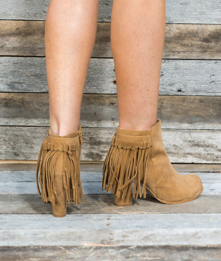 Our western inspired tan fringe booties are the fashion-forward cowgirl's dream. They have a chunky heel that's higher than most booties and faux suede finish. The rounded toe and fringe accents in th