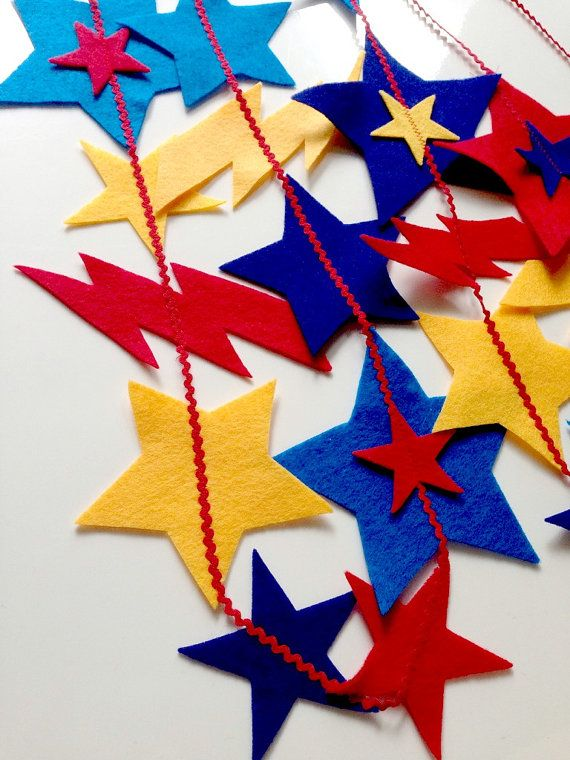Superheroes Theme - A garland, made out of felt stars in primary colours. Pretty enough to keep up all year round.