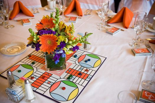 Board game centerpiece. Let your guests play while they wait! Alternative wedding table decor.