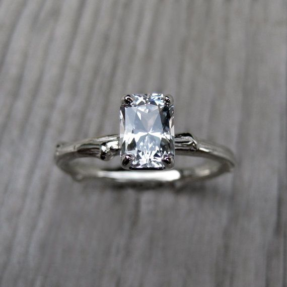 A real twig is cast in solid recycled 14k gold to create the unique ring shank. Set upon the branch is a sparkling white emerald-cut sapphire, prong-set in a basket setting.  Featured on Huffington Post Weddings! - Kristin Coffin custom jewelry  $1,250.00